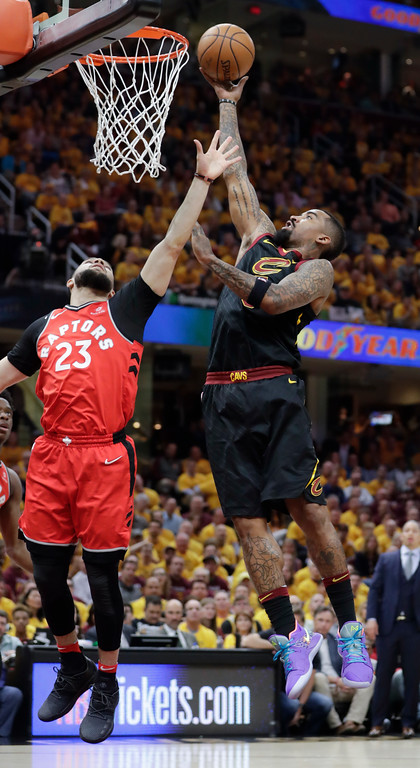 . Cleveland Cavaliers\' JR Smith goes up for a shot against Toronto Raptors\' Fred VanVleet (23) in the first half of Game 4 of an NBA basketball second-round playoff series, Monday, May 7, 2018, in Cleveland. (AP Photo/Tony Dejak)