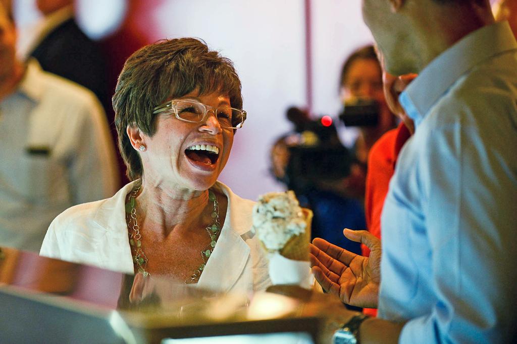 . Senior advisor Valerie Jarrett tells the president she already had ice cream before he arrived as President Barack Obama orders a cone at the Grand Old Creamery in St. Paul on Thursday. (Pioneer Press: Ben Garvin)