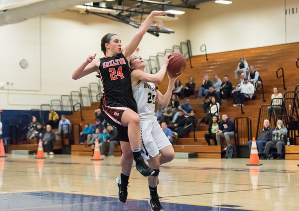 02/26/19 Wesley Bunnell   Staff Newington girls basketball vs Shelton in a CIAC playoff game played at home on Tuesday night. Aby Flores (21) is fouled by the Shelton defender but the bucket would count to put Newington up 53-49.
