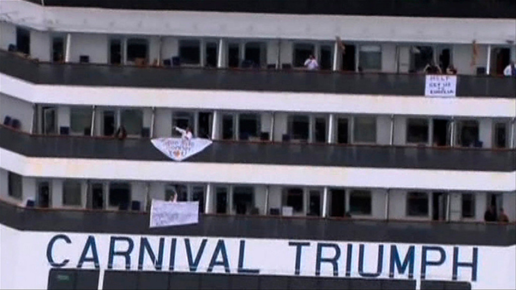 . People wave and hang signs at the side of their balconies on the cruise ship Carnival Triumph cruise ship in this video frame grab from NBC News taken off the coast of Alabama, February 14, 2013.  REUTERS/NBC News/Handout