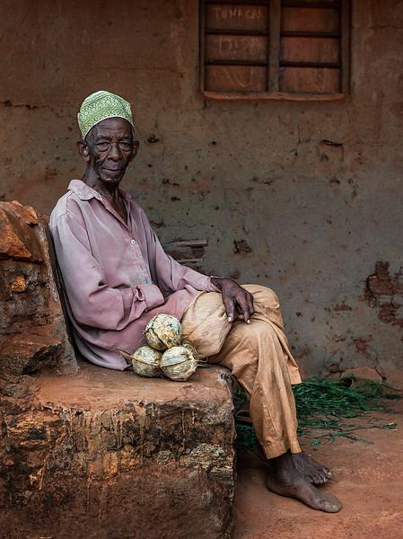 Coconut salesman in a small village just north of Pangani.  Tanzania, 2019.