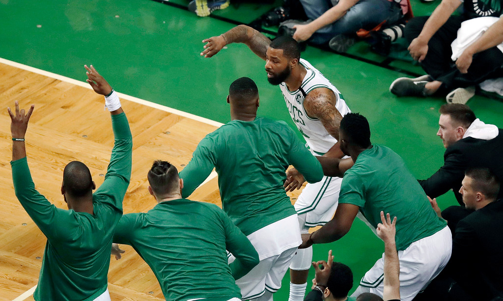 . Boston Celtics forward Marcus Morris, rear, celebrates with teammates after hitting a three-point basket during the first half in Game 7 of the NBA basketball Eastern Conference finals against the Cleveland Cavaliers, Sunday, May 27, 2018, in Boston. (AP Photo/Charles Krupa)