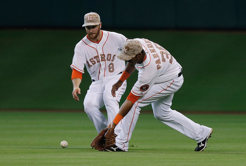 . Jimmy Paredes #38 and Trevor Crowe #8  of the Houston Astros fail to make a catch in center field during the third inning against the Colorado Rockies at Minute Maid Park on May 27, 2013 in Houston, Texas.  (Photo by Scott Halleran/Getty Images)