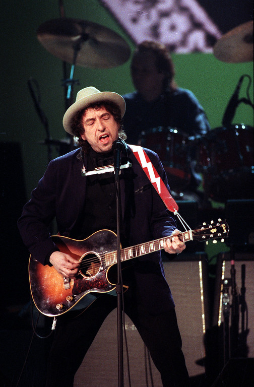 . Rock and folk singer Bob Dylan performs during the 33rd Annual Grammy Awards at New York\'s Radio City Music Hall, Wednesday night, Feb. 21, 1991.  Dylan was awarded a lifetime achievement award.  (AP Photo/Ron Frehm)
