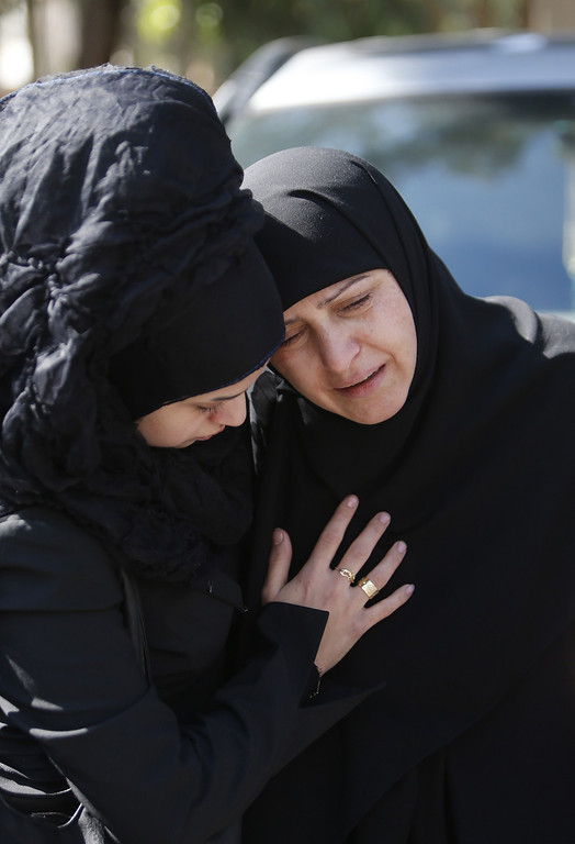 . A Lebanese woman comforts a relative of one of the victims outside an hospital on February 19, 2014, following a bomb explosion in a southern suburb of the capital Beirut.  AFP PHOTO / STR-/AFP/Getty Images