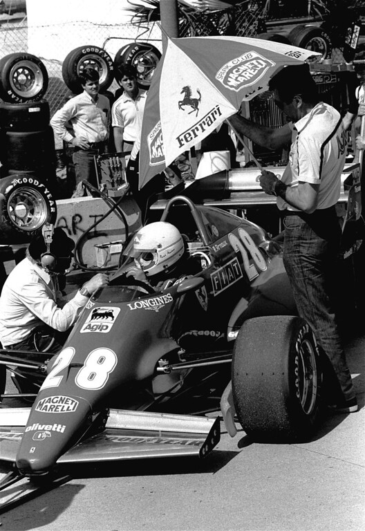 . Rene Arnoux of France sits in his Ferrari as he talks with pit crew during Friday afternoon qualifying for Sunday\'s Long Beach Grand Prix Formula 1 race, March 26, 1983. Arnoux was Friday\'s top qualifier with an average speed of 84.269 mph. (AP Photo/Lennox McLendon)