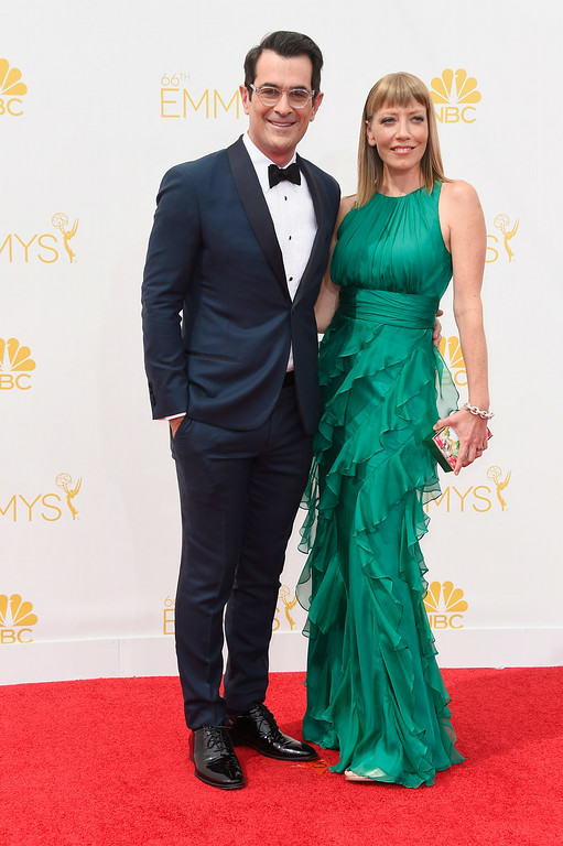 . Actor Ty Burrell (L) and Holly Anne Brown attend the 66th Annual Primetime Emmy Awards held at Nokia Theatre L.A. Live on August 25, 2014 in Los Angeles, California.  (Photo by Frazer Harrison/Getty Images)