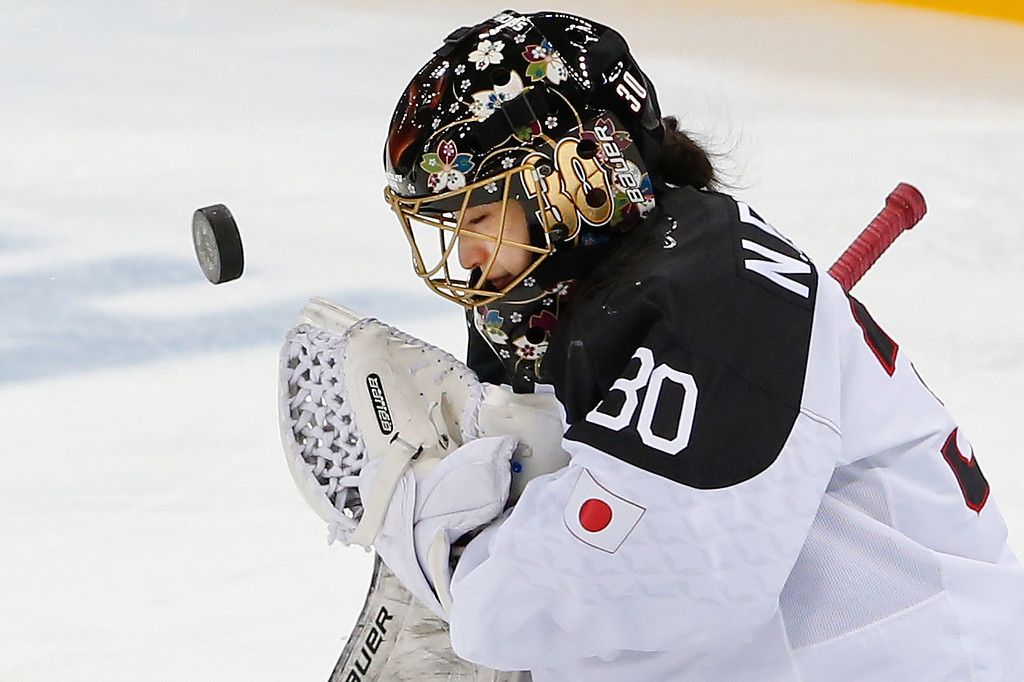 . Goalkeeper Nana Fujimoto of Japan blocks a shot on goal during the second period of the 2014 Winter Olympics women\'s ice hockey game against Germany at Shayba Arena, Tuesday, Feb. 18, 2014, in Sochi, Russia. (AP Photo/Petr David Josek)