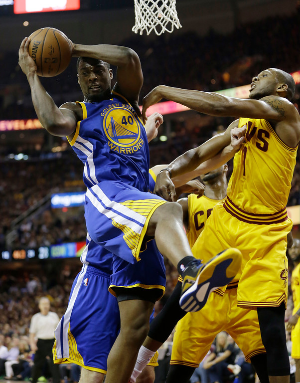 . Golden State Warriors forward Harrison Barnes (40) grabs a rebound in front of Cleveland Cavaliers forward James Jones (1) during the first half of Game 4 of basketball\'s NBA Finals in Cleveland, Thursday, June 11, 2015. (AP Photo/Tony Dejak)