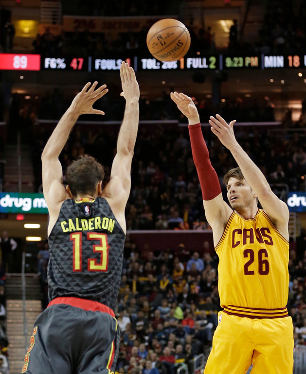. Cleveland Cavaliers\' Kyle Korver (26) shoots over Atlanta Hawks\' Jose Calderon (13) in the second half of an NBA basketball game, Friday, April 7, 2017, in Cleveland. (AP Photo/Tony Dejak)