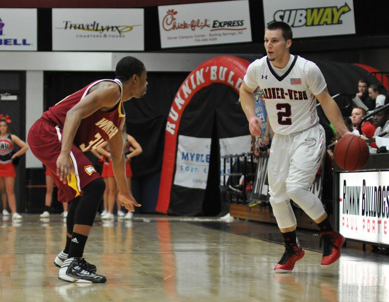 Tyler Strange drives down the court against Winthrop University Tuesday February 19, 2013.