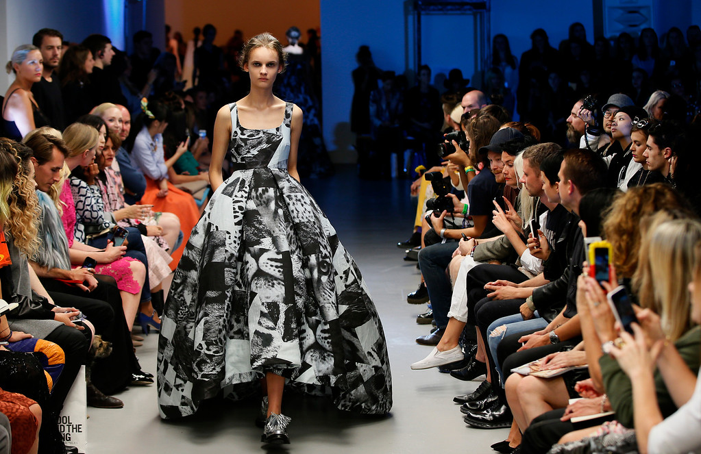 . A model wears an outfit by designer Giles Deacon during his Spring/Summer 2015 show at London Fashion Week in London, Monday, Sept. 15, 2014. (AP Photo/Alastair Grant)