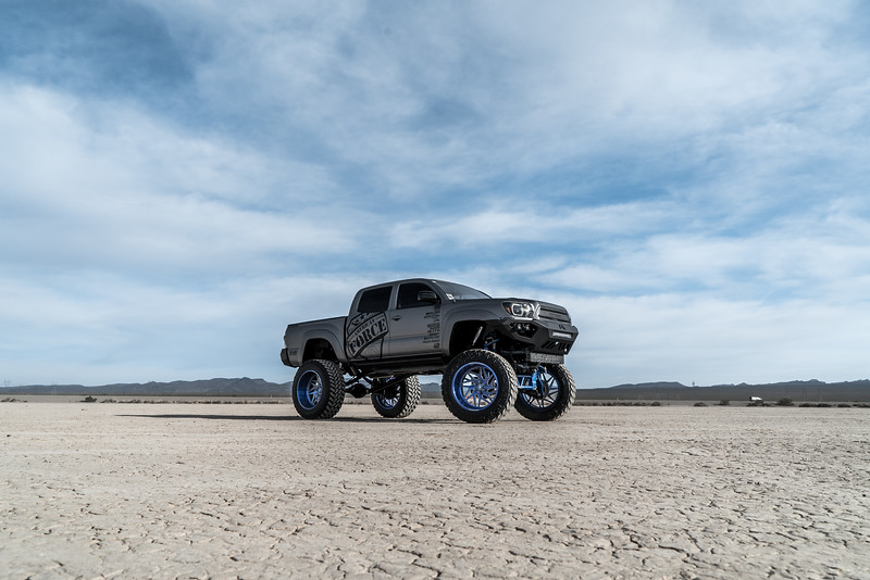 @T_harper96 @Vengeance_tacoma 2005-15 Toyota Tacoma featuring our New 2019 Concave 24x14 Lollipop Blue #GENESIS wrapped in 40x1550x24 @NittoTire-59.jpg