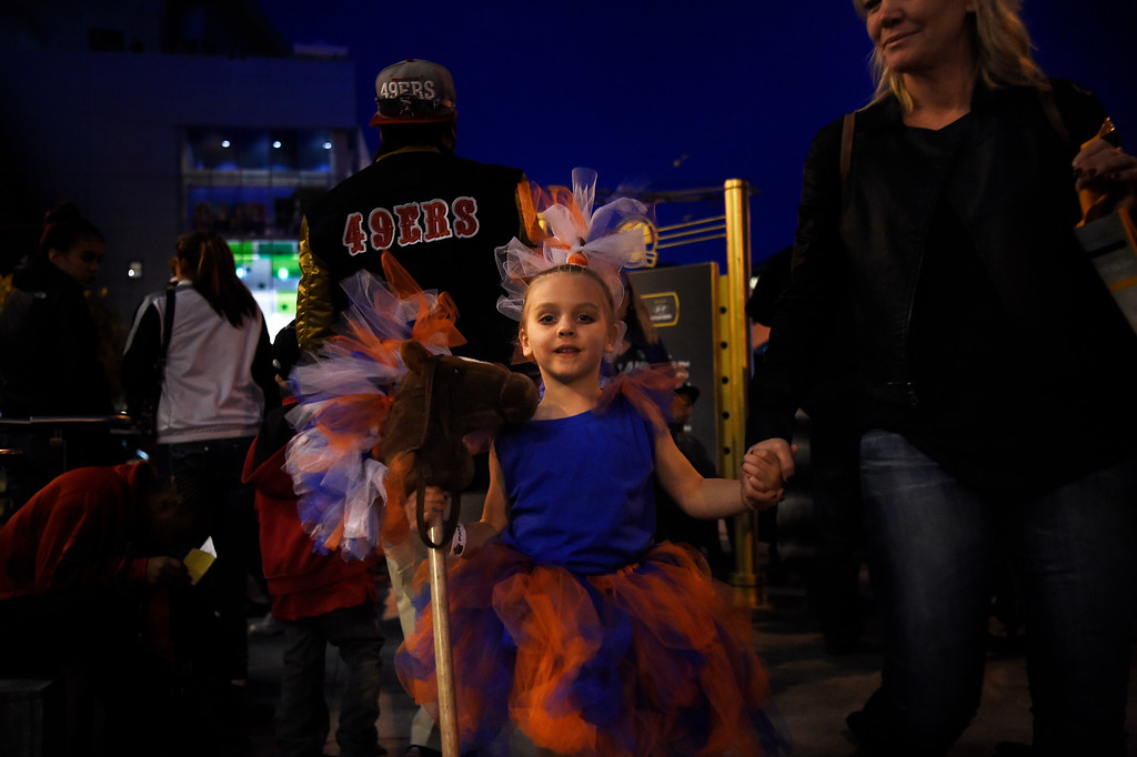 . SAN FRANCISCO, CA - FEBRUARY 05: Little Thunder, 5 year old Grace Johnson and her mother Jenna make their way through the crowds outside of the NFL Experience in downtown San Francisco, CA. February 05, 2016 (Photo by Joe Amon/The Denver Post)