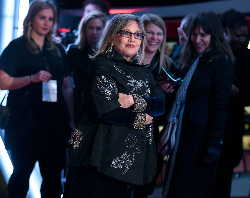 """. Carrie Fisher arrives at the world premiere of \""""Star Wars: The Force Awakens\"""" at the TCL Chinese Theatre on Monday, Dec. 14, 2015, in Los Angeles. (Photo by Jordan Strauss/Invision/AP)"""