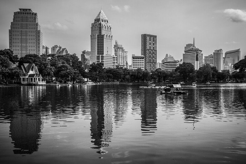 Stunning cityscape and amazing reelection captured at Lumphini Park.