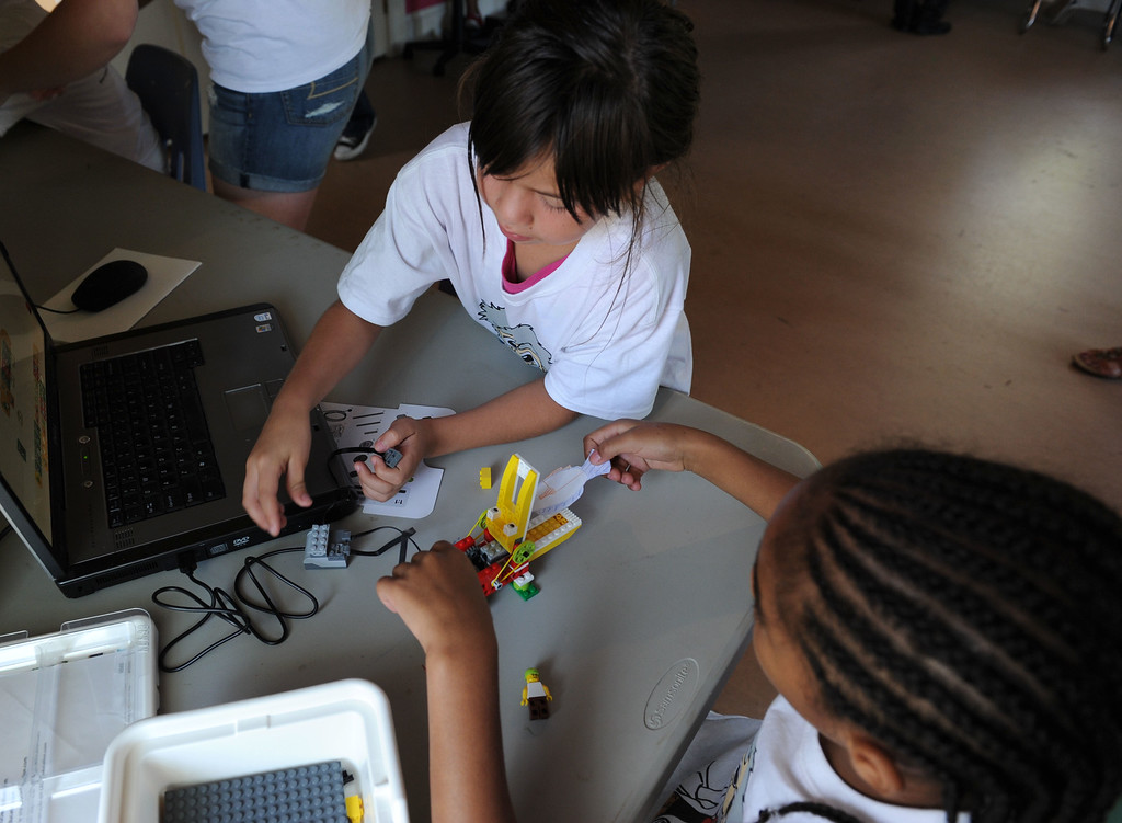 . (John Valenzuela/Staff Photographer) Teresa Flores, 8, and Trinity Weaver, 9,work on their robotic lego alligator, during The Boys and Girls Club�s of Redlands\' Camp Einstein Camp, Thursday\'s at the Burrage Mansion in Redlands, Aug. 2, 2013. Camp Einstein campers used Lego Education WeDo Robotics and assembled a robotic Lego alligator features working motors and sensors, then add movement with a computer program to control the robotic animal.