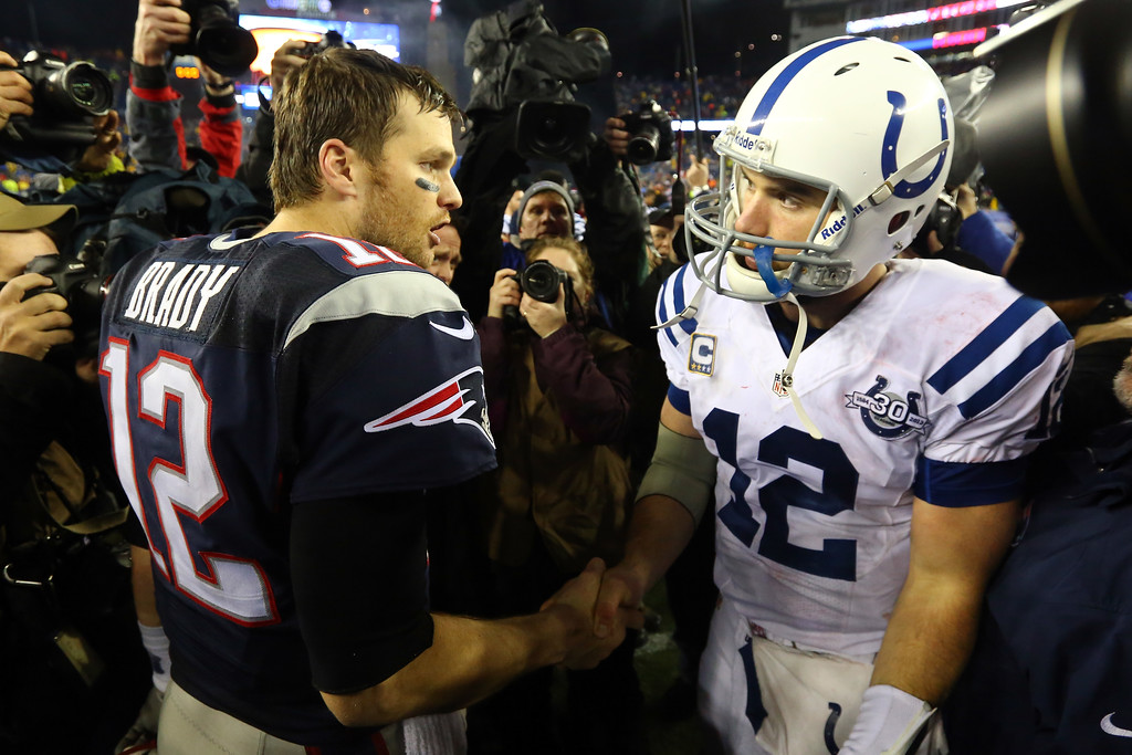 . FOXBORO, MA - JANUARY 11:  (L-R) Tom Brady #12 of the New England Patriots shakes hands with Andrew Luck #12 of the Indianapolis Colts after their AFC Divisional Playoff game at Gillette Stadium on January 11, 2014 in Foxboro, Massachusetts. The New England Patriots defeated the Indianapolis Colts 43 to 22.  (Photo by Al Bello/Getty Images)