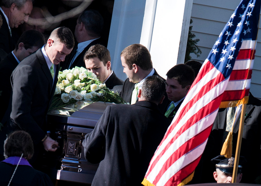 Description of . Loved ones carry a casket with the remains of Victoria Soto, age 27 from Lordship Community Church after a funeral for the slain teacher December 19, 2012 in Stratford, Connecticut. Victoria Soto, a first grade teacher who is being hailed as a hero, was one of 6 adults in addition to 20 children who were killed in last Friday's shooting at Sandy Hook Elementary School.  TOPSHOTS/AFP PHOTO/Brendan  SMIALOWSKI/AFP/Getty Images