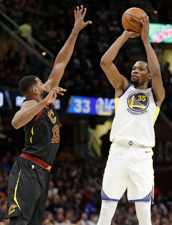 . Golden State Warriors\' Kevin Durant (35) shoots over Cleveland Cavaliers\' Tristan Thompson (13) in the second half of an NBA basketball game, Monday, Jan. 15, 2018, in Cleveland. (AP Photo/Tony Dejak)