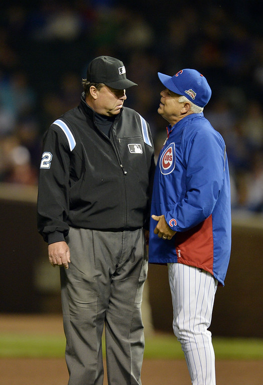 . Manager Rick Renteria #16 of the Chicago Cubs asks second base umpire Gerry Davis #12 for a review of a play during the fourth inning against the Colorado Rockies on July 29, 2014 at Wrigley Field in Chicago, Illinois.  (Photo by Brian Kersey/Getty Images)