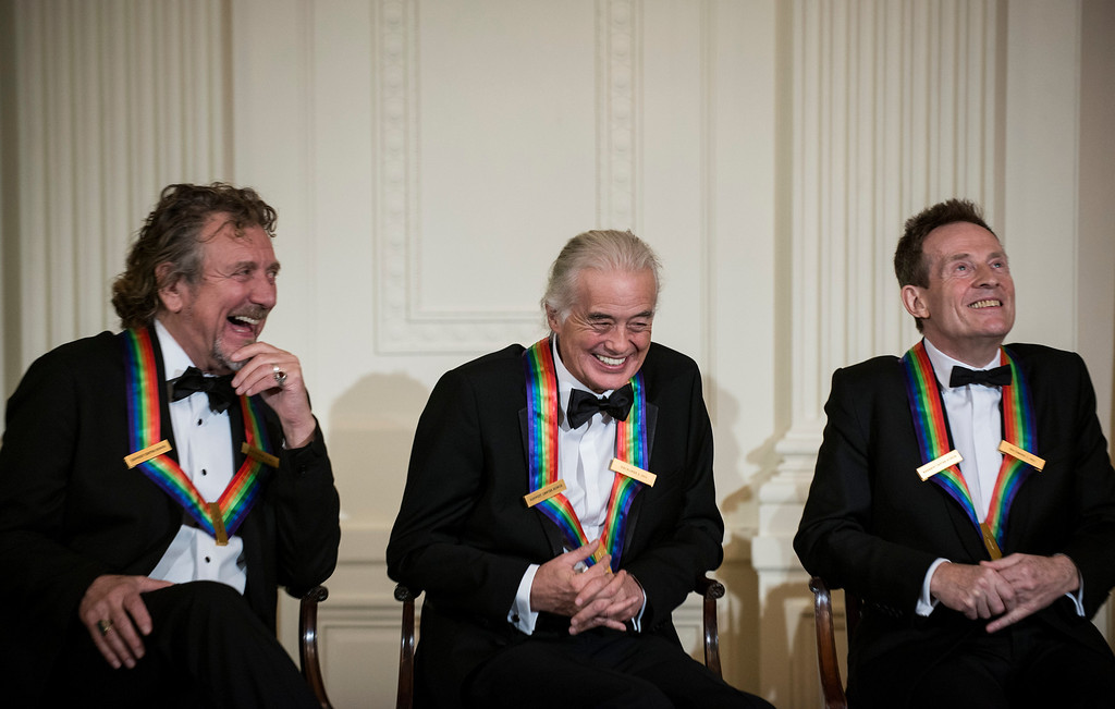 . (L-R) Led Zeppelin band members Robert Plant, Jimmy Page, John Paul Jones listen during an event in the East Room of the White House December 2, 2012 in Washington, DC. US President Barack Obama and First Lady Michelle Obama attended the event at the White House with the 2012 Kennedy Center Honorees to celebrate their contribution to the arts before heading to the Kennedy Center for the honors program.    BRENDAN SMIALOWSKI/AFP/Getty Images