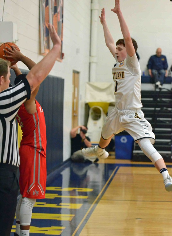 . Paul DiCicco - The News-Herald Kirtland�s Dominic Capretta trying to block the inbound pass.