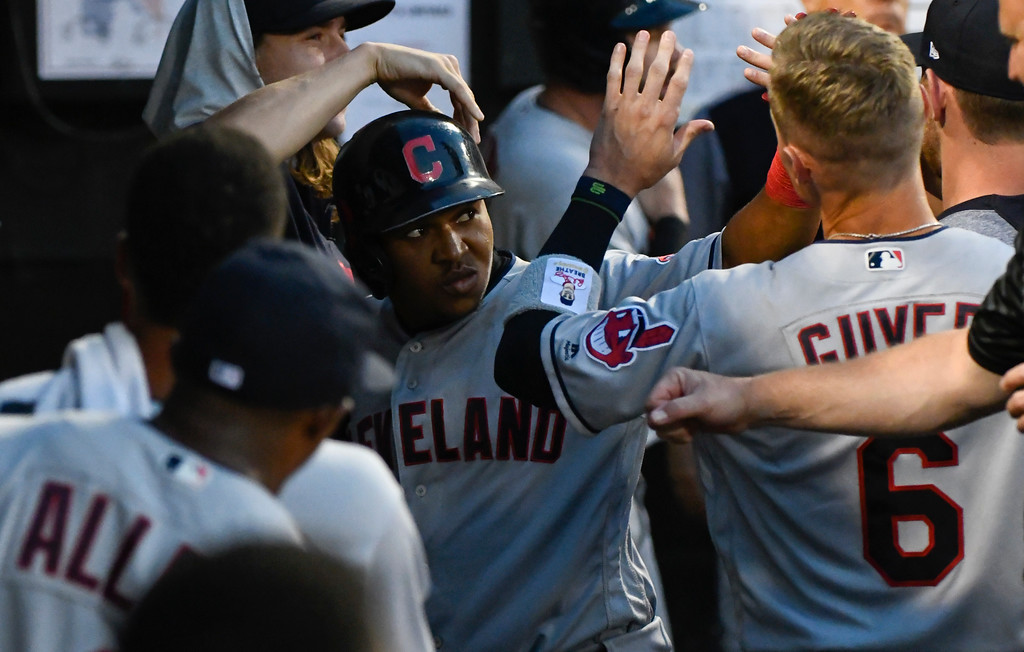 . Cleveland Indians\' Jose Ramirez, center, celebrates with Brandon Guyer (6) after his home run against the Chicago White Sox during the sixth inning of a baseball game on Saturday, Aug. 11, 2018, in Chicago. (AP Photo/Matt Marton)