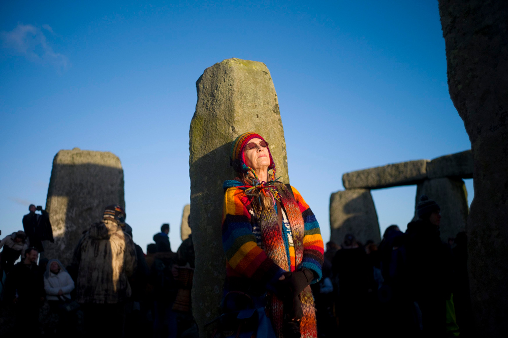 Description of . A reveller meditates as the sun rises during the winter solstice at Stonehenge on Salisbury plain in southern England December 21, 2012. The winter solstice is the shortest day of the year, and the longest night of the year. REUTERS/Kieran Doherty