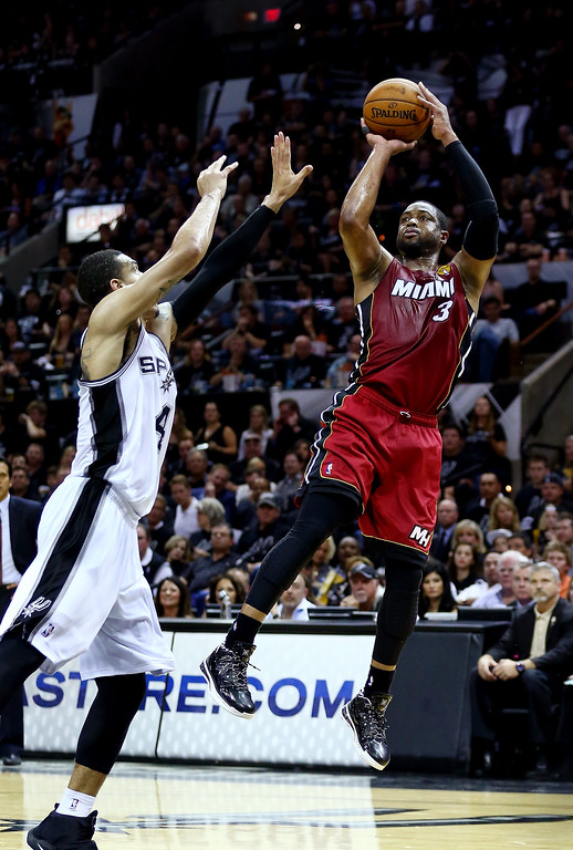 . Dwyane Wade #3 of the Miami Heat takes a shot over Danny Green #4 of the San Antonio Spurs during Game One of the 2014 NBA Finals at the AT&T Center on June 5, 2014 in San Antonio, Texas.   (Photo by Andy Lyons/Getty Images)