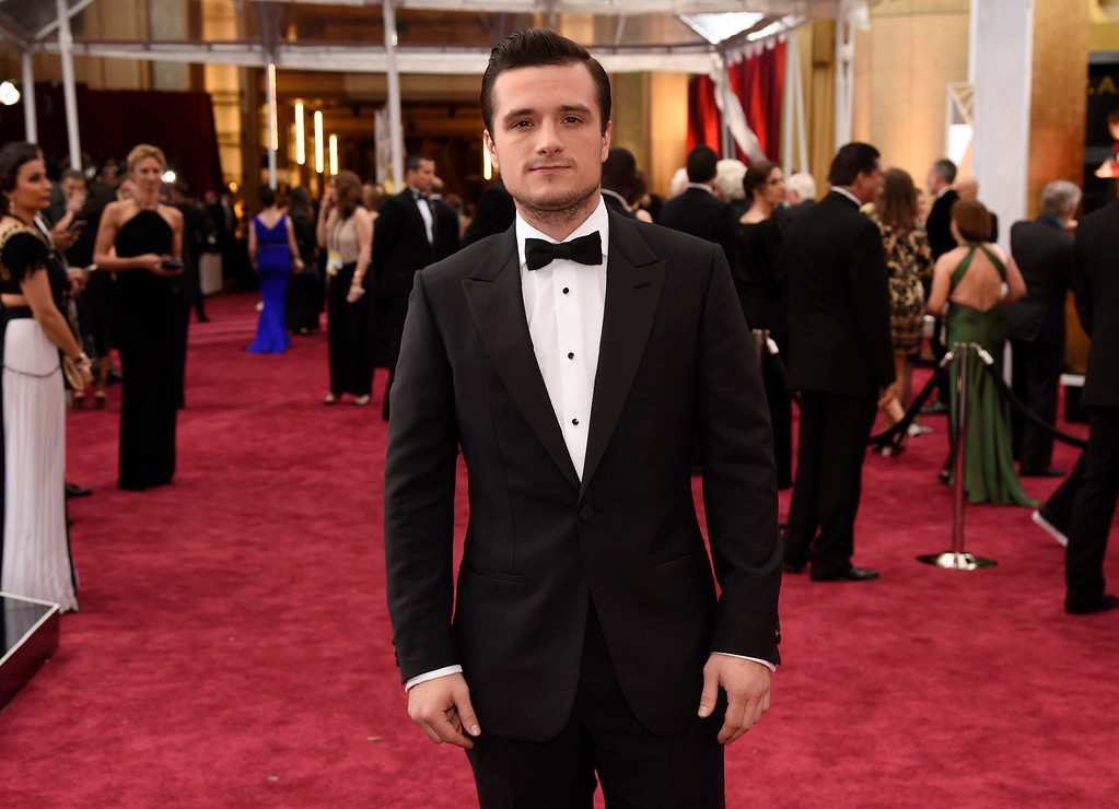 . Josh Hutcherson arrives at the Oscars on Sunday, Feb. 22, 2015, at the Dolby Theatre in Los Angeles. (Photo by Chris Pizzello/Invision/AP)