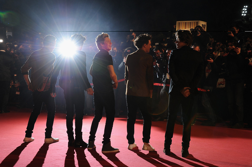 """. CANNES, FRANCE - JANUARY 26: Menbers of band \""""One Direction\"""" attend the NRJ Music Awards 2013 at Palais des Festivals on January 26, 2013 in Cannes, France.  (Photo by Pascal Le Segretain/Getty Images)"""