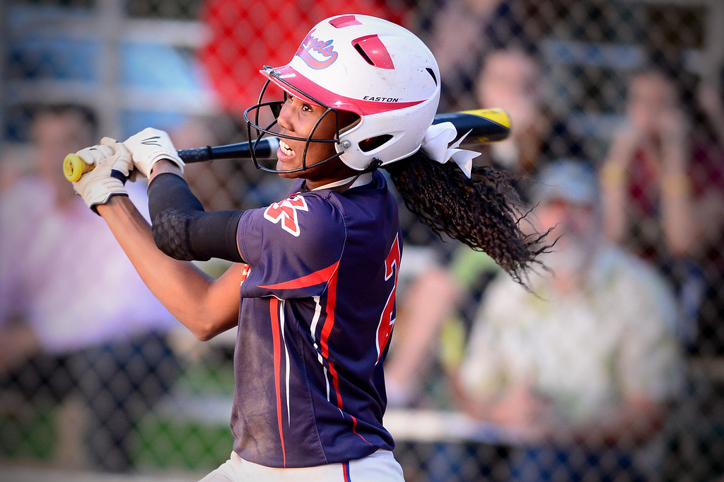 . La Salle\'s Kinsley Washington (2) makes a hit during the West SGV softball all-star game Wednesday night, June 11, 2014 at Live Oak Park in Temple City. (Photo by Sarah Reingewirtz/Pasadena Star-News)