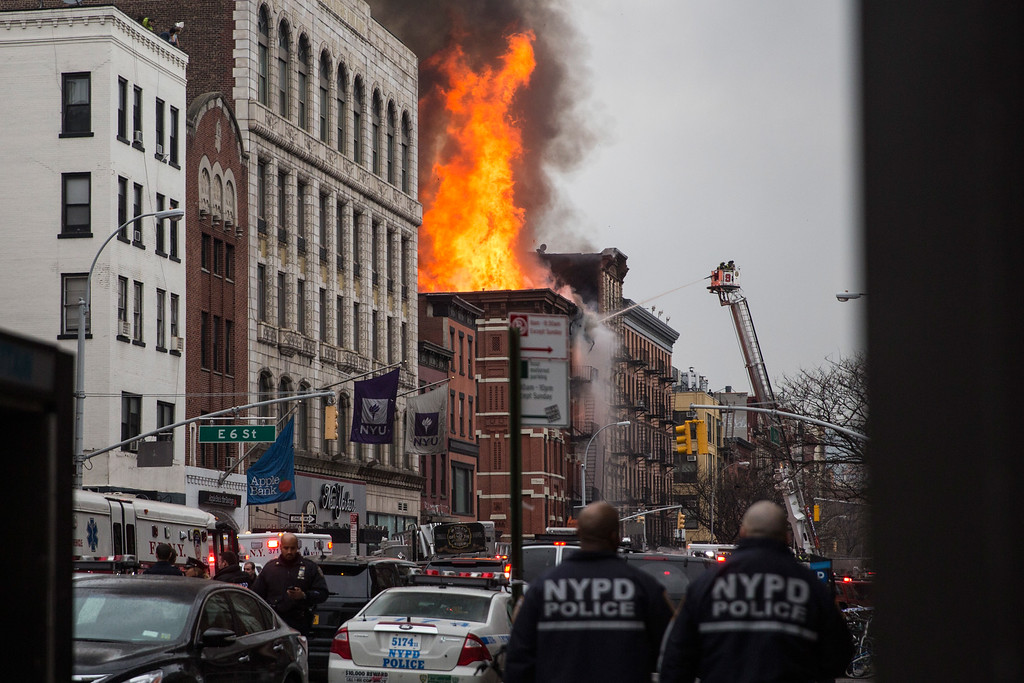 . NEW YORK, NY - MARCH 26:  A building burns after an explosion on 2nd Avenue on March 26, 2015 in New York City. The seven alarm fire drew firefighters from across the city. A number of injuries have been reported. (Photo by Andrew Burton/Getty Images)