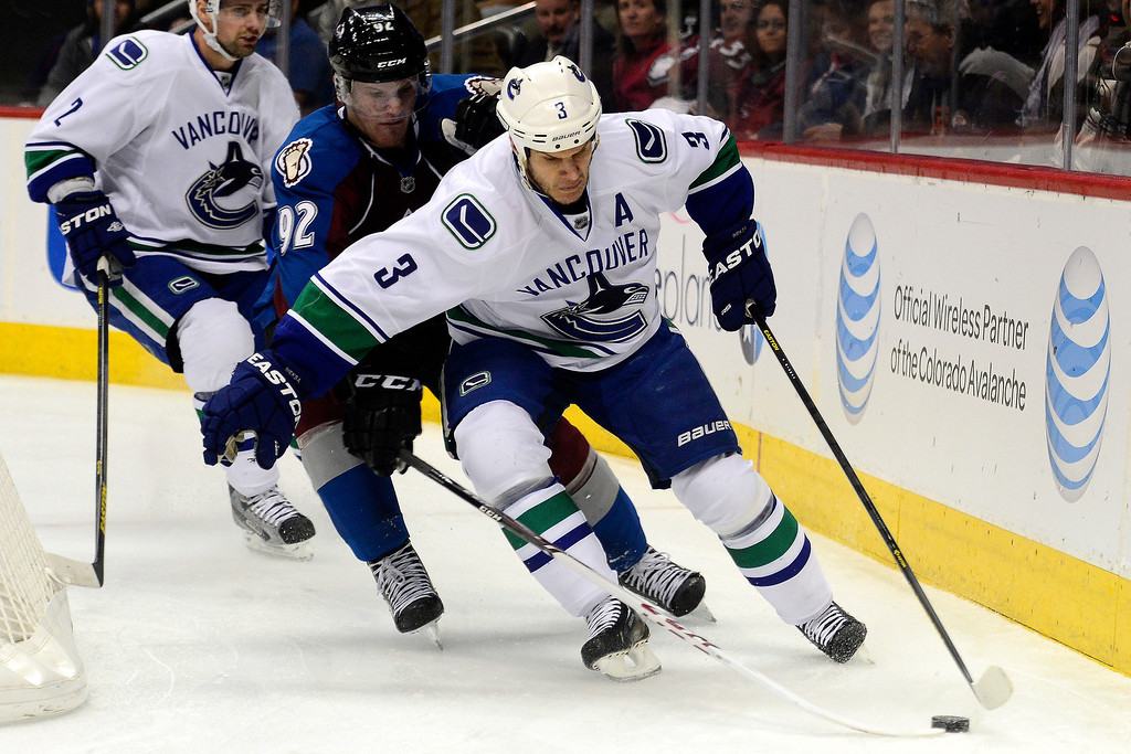 . DENVER, CO - MARCH 24: Gabriel Landeskog (92) of the Colorado Avalanche defends Kevin Bieksa (3) of the Vancouver Canucks during the first period of action. Colorado Avalanche versus the Vancouver Canucks at the Pepsi Center. (Photo by AAron Ontiveroz/The Denver Post)