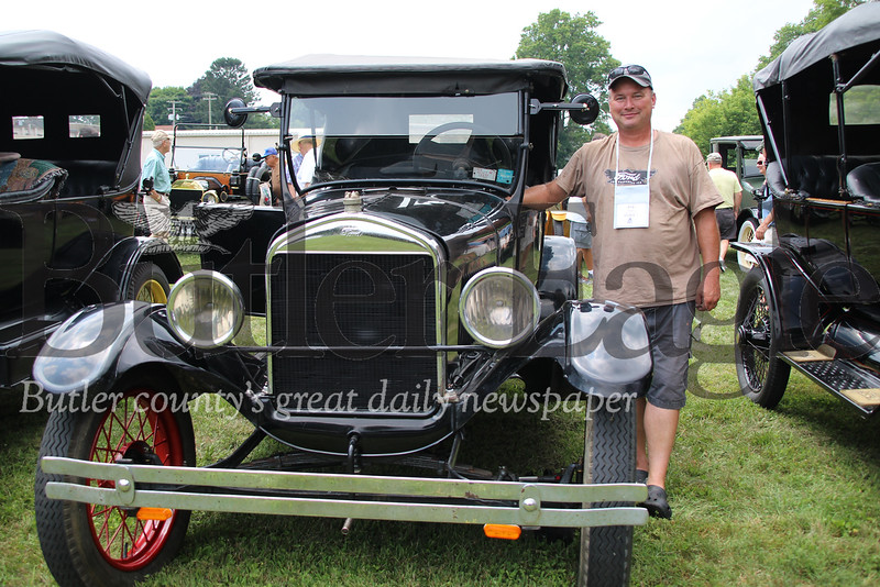 Erik Krause of Silver Springs, Maryland, stands with his 1927 Model T Ford car, Sunday in Saxonburg at the Model T exhibition. Rachael McKriger/Butler Eagle