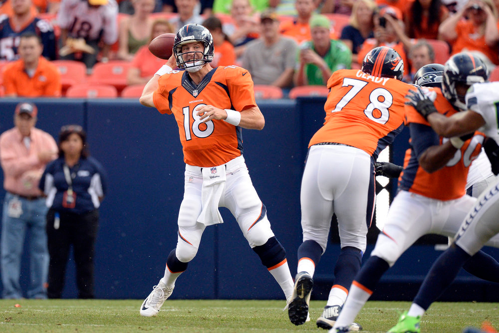 . Quarterback Peyton Manning (18) of the Denver Broncos throws a pass during the first quarter.  The Denver Broncos vs the Seattle Seahawks At Sports Authority Field at Mile High. (Photo by John Leyba/The Denver Post)