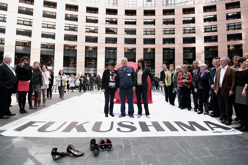 ". Naoto Mastumura (C), nicknamed ""the last man of Fukushima\"" poses after addressing European MPs, on March 11, 2014, at the European Parliament in Strasbourg, on the third anniversary of the tragic events following the tsunami and the resulting nuclear disaster in Fukushima. (FREDERICK FLORIN/AFP/Getty Images)"