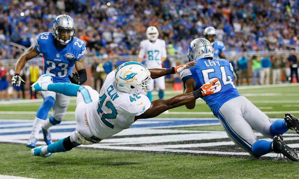 . Detroit Lions outside linebacker DeAndre Levy (54) deflects a pass intended for Miami Dolphins tight end Charles Clay (42) in the end zone during the first half of an NFL football game in Detroit, Sunday, Nov. 9, 2014. (AP Photo/Rick Osentoski)