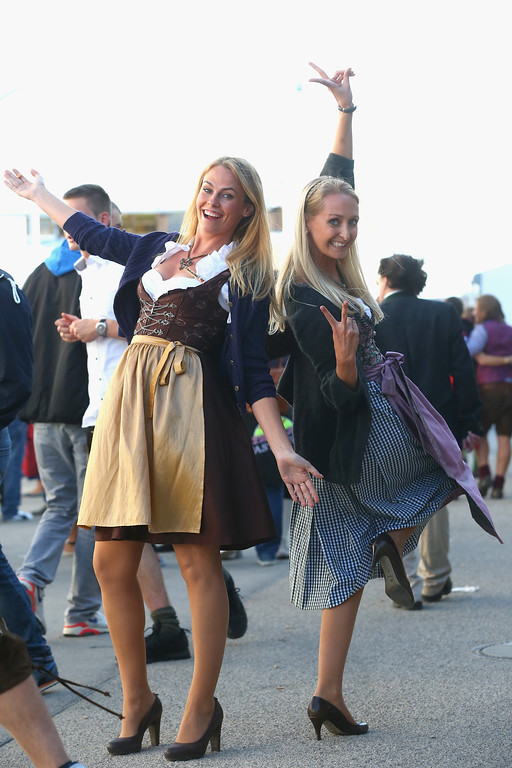 . Revelers dressed in traditional Bavarian clothing `Dirndl` during day 1 of the Oktoberfest 2013 beer festival at Theresienwiese on September 21, 2013 in Munich, Germany. The Munich Oktoberfest, which this year will run from September 21 through October 6, is the world\'s largest beer fest and draws millions of visitors.  (Photo by Alexander Hassenstein/Getty Images)
