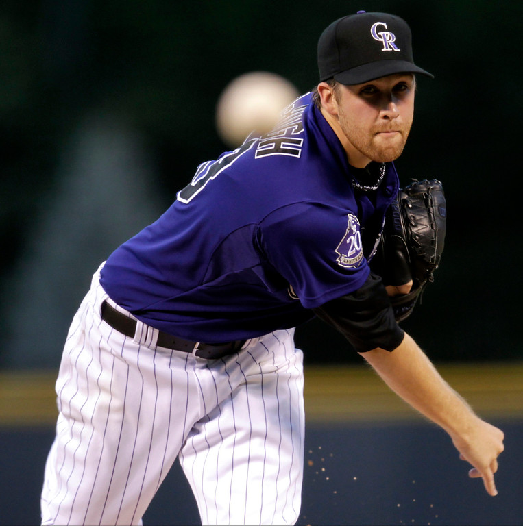 . Colorado Rockies starting pitcher Collin McHugh delivers against the St. Louis Cardinals during the first inning of a baseball game on Monday, Sept. 16, 2013, in Denver. (AP Photo/Joe Mahoney)