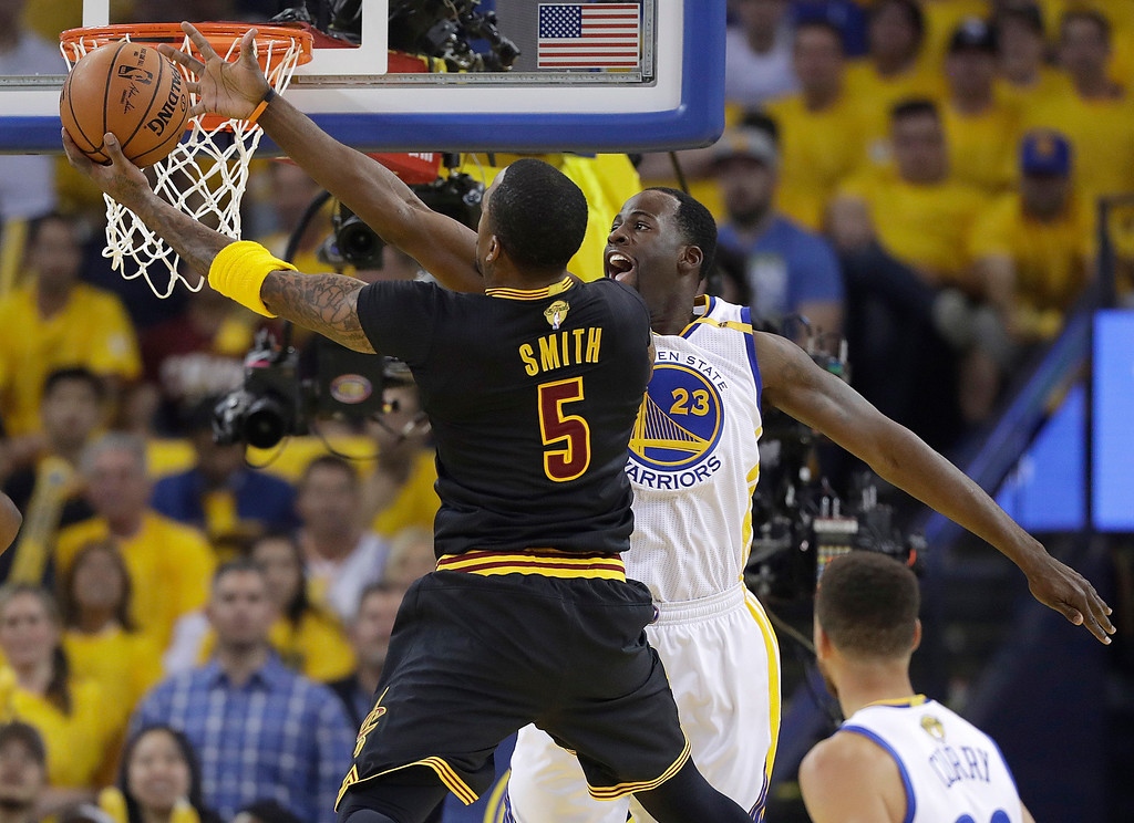 . Golden State Warriors forward Draymond Green (23) defends a shot by Cleveland Cavaliers guard J.R. Smith (5) during the first half of Game 5 of basketball\'s NBA Finals in Oakland, Calif., Monday, June 12, 2017. (AP Photo/Marcio Jose Sanchez)