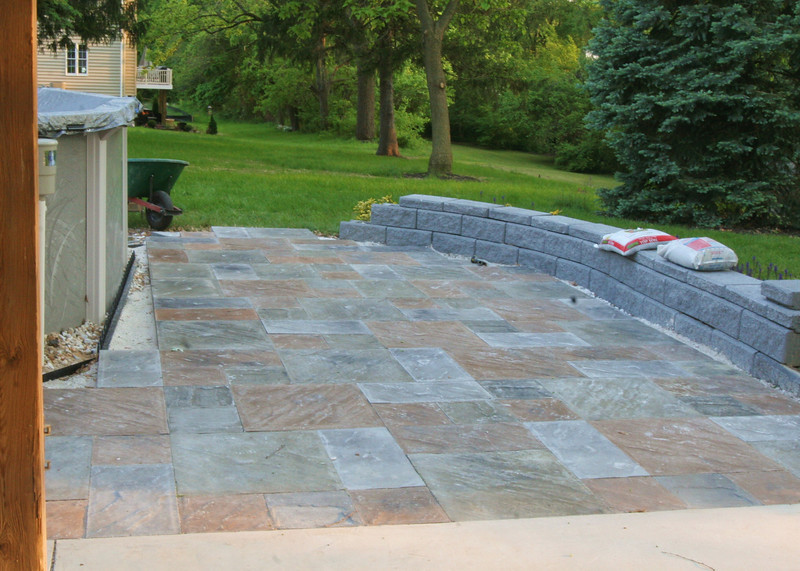 These are concrete pavers. They are called slatecrete b/c it is made to look like slate. It has a 8500 PSI and his very durable as well as sharp looking. Some of the pavers were 100lbs and were laid in a mosiac patern.