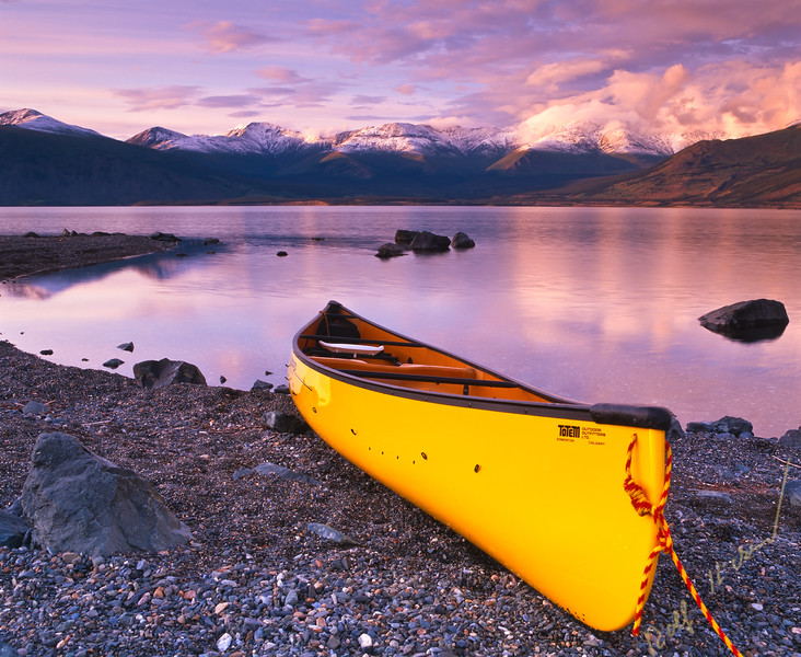 Yellow canoe on the shore of Kluane Lake in Kluane National Park, Yukon, Canada.