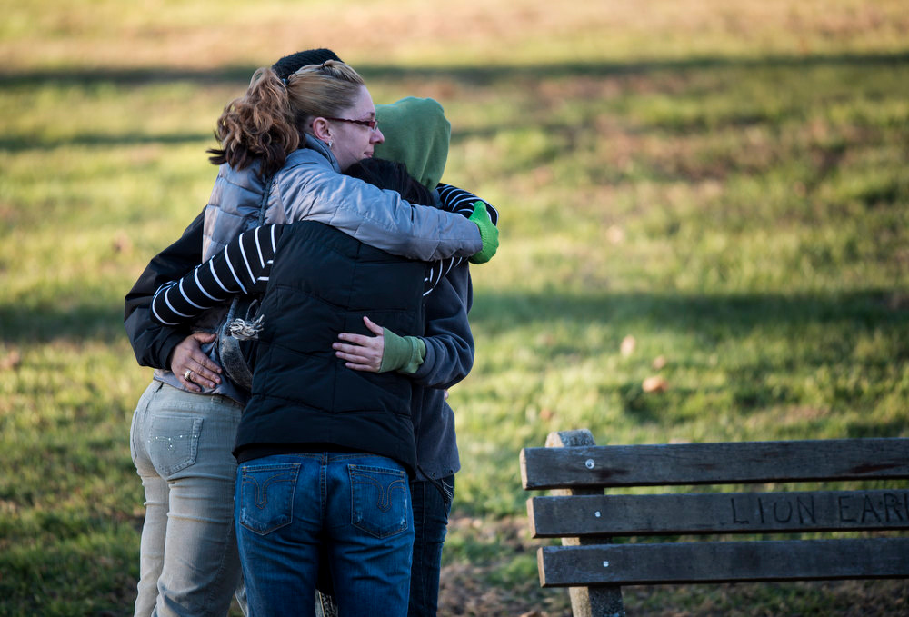 Description of . Mourners hug outside Woodbury Funeral Home during calling hours for Dawn Hochsprung on December 19, 2012 in Woodbury, Connecticut. Dawn Lafferty Hochsprung, the principle of Sandy Hook Elementary School, was one of 6 adults in addition to 20 children who were killed in last Friday's shooting at Sandy Hook.  AFP PHOTO/Brendan  SMIALOWSKI/AFP/Getty Images