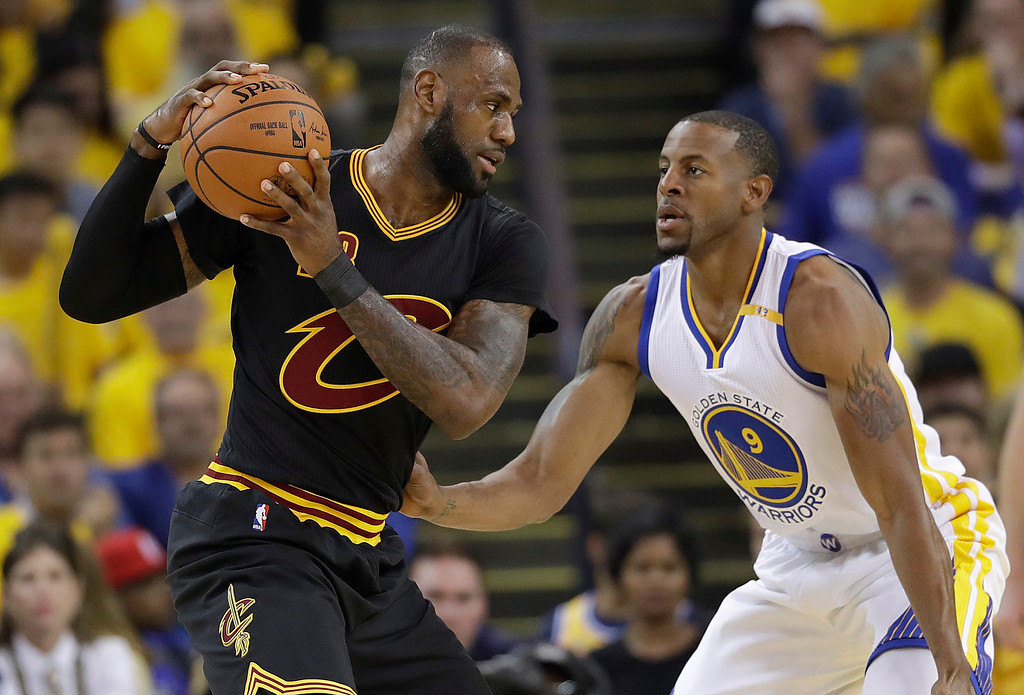 . Cleveland Cavaliers forward LeBron James (23) is guarded by Golden State Warriors forward Andre Iguodala (9) during the first half of Game 5 of basketball\'s NBA Finals in Oakland, Calif., Monday, June 12, 2017. (AP Photo/Marcio Jose Sanchez)
