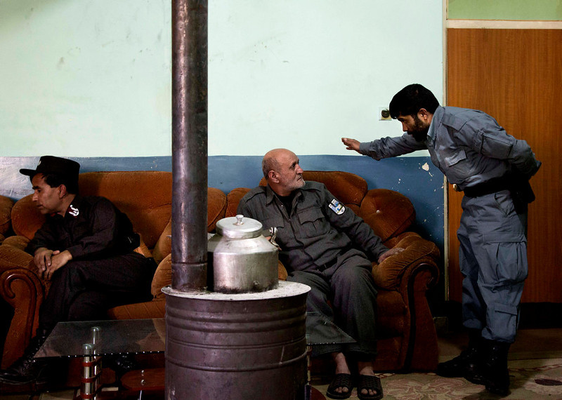 . Maj. Mohammed Arif, left, Counter terrorism officer and Police man Abdul Ghafoor enjoy a break at the police headquarters in Maidan Shahr, Wardak province, Afghanistan, Sunday, March 10, 2013. Afghan President Hamid Karzai, infuriated by villager reports of forced detentions and mass arrests, gave U.S. Special Forces two weeks to vacate Wardak province, located barely 30 kilometers (24 miles) from the Afghan capital of Kabul. The deadline for their withdrawal expired midnight Sunday, March 10, 2013. (AP Photo/Anja Niedringhaus)