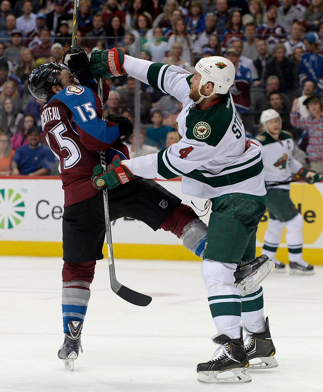 . DENVER, CO - APRIL 26: Minnesota Wild defenseman Clayton Stoner (4) pushes Colorado Avalanche right wing P.A. Parenteau (15) during the third period of action. The Colorado Avalanche hosted the Minnesota Wild in the fifth round of the Stanley Cup Playoffs at the Pepsi Center in Denver, Colorado on Saturday, April 26, 2014. (Photo by John Leyba/The Denver Post)