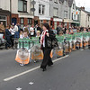 Boys & Girls carring posters to remember republicans who have given their lives during the troubles,