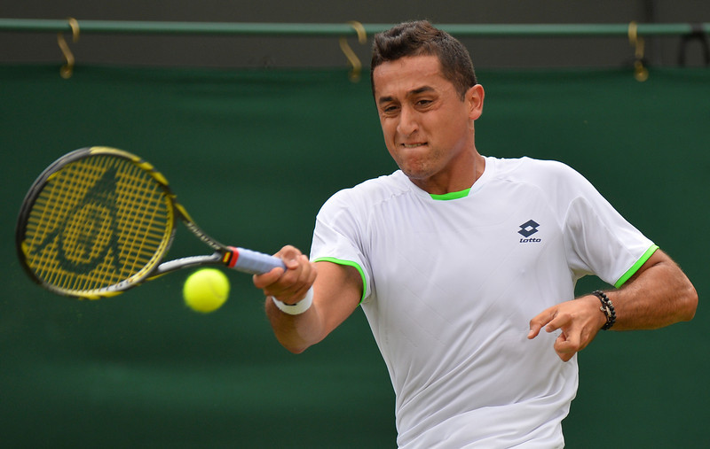 . Spain\'s Nicolas Almagro returns against France\'s Guillaume Rufin during their second round men\'s singles match on day three of the 2013 Wimbledon Championships tennis tournament at the All England Club in Wimbledon, southwest London, on June 26, 2013. Almagro won 7-5, 6-7, 6-3, 6-4. BEN STANSALL/AFP/Getty Images